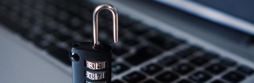 plagiarism protection: padlock on a laptop keyboard